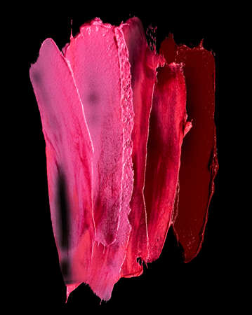 Lipstick smears of different colors isolated on black background