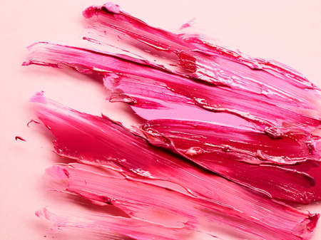 Smudged lipstick over pink background Banque d'images