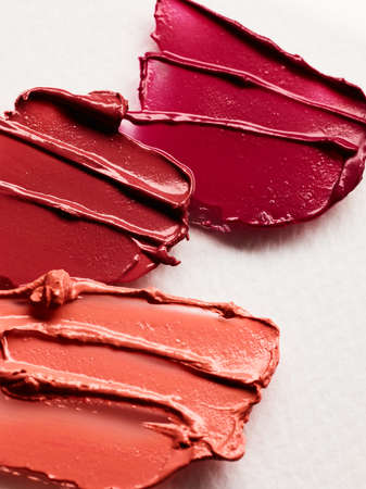 Lipstick smears over white background