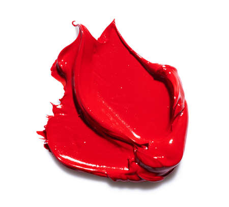 Red paint smear over white background Banque d'images