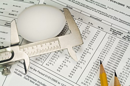 Nest Egg being measured against a background of 401K investment statements and documents.