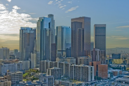 highrises: Los Angeles skyline in daylight against blue sky. Stock Photo