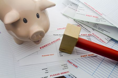 remit: Piggy bank and hammer with overdue household bill indicating frustration with not enough money. Stock Photo