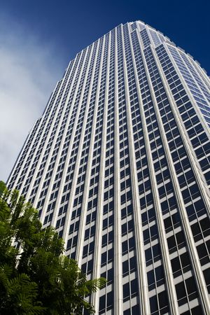 Modern office building against blue sky with clouds. Reklamní fotografie