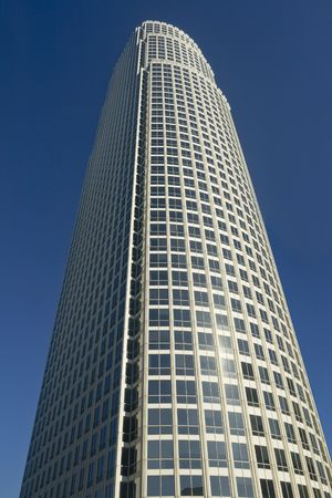 Example of modern architecture in an urban atmosphere against blue sky shot from below.