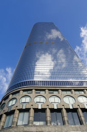 Example of modern architecture in an urban atmosphere shot from below against a blue sky.