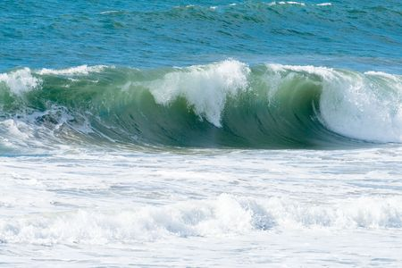 Pacific Ocean waves and surf in early morning.