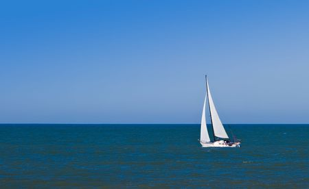 Sailboat on Pacific Ocean on a clear,sunny day. Imagens
