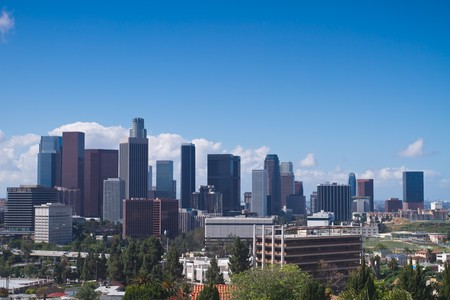 shown: Skyline of Los Angeles shown at early dusk with blue sky. Stock Photo