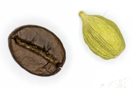 Coffee and cardamom on a white background photo