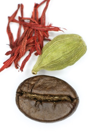 Coffee, cardamom and saffron  on a white background. photo