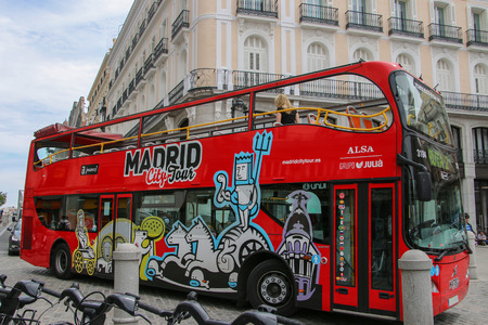 MADRID, SPAIN -April 23: Tourist bus in Madrid, Spain. Madrid City Tour is a new official touristic bus service that shows the city with an audio guide.