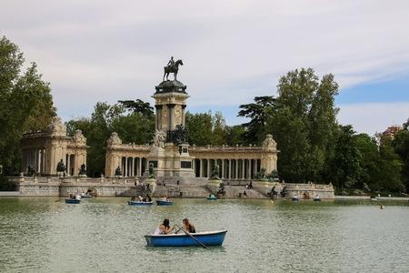parque del buen retiro: Madrid, Spain - april 23, 2015: people riding small boats at Parque del Buen Retiro.