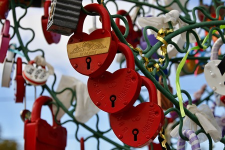 in memory: Closed padlocks in the form of heart Stock Photo