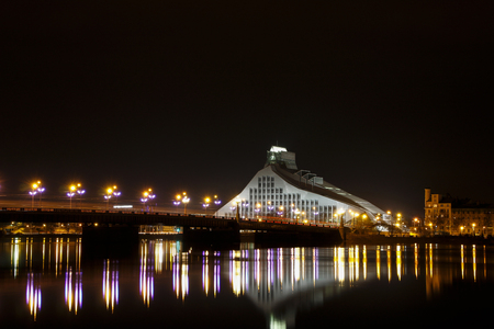 shrouds: Night scene of the bridge and the National Library of Riga.