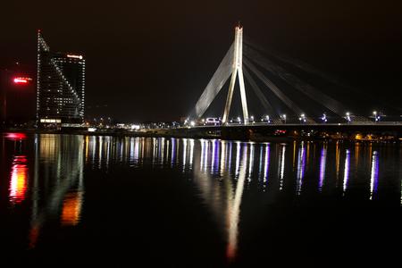 brige: The night scene of the Vansu bridge over river Daugava, Riga, Latvia.