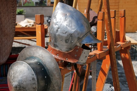 knightly: old knight helmet for protection in battle. is made of metal. part of knightly armor Stock Photo