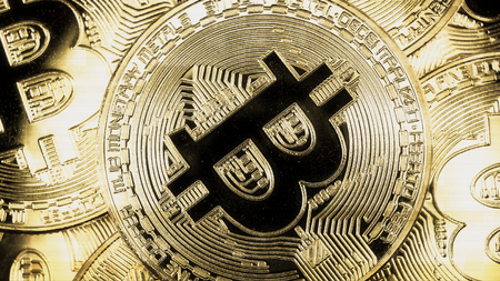 electronic commerce: Crypto currency Gold Bitcoin - BTC - Bit Coin. Macro shots crypto currency Bitcoin coins. Holomatrix style Stock Photo