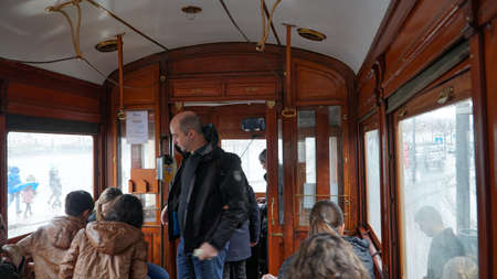 Porto, Portugal, circa 2018: Interior of an old tram, passing through the streets of Porto, Portugal.