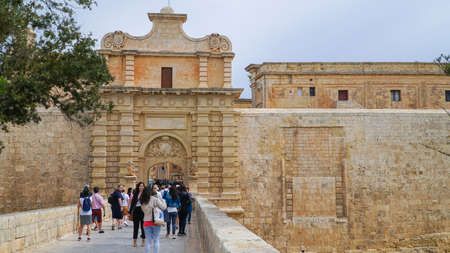 Mdina - MALTA, April, 2018: Gate in the ancient medieval city of Mdina. Mdina is a popular tourist destination in Malta.