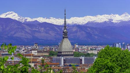 Turin Torino aerial timelapse skyline panorama with Mole Antonelliana, Monte dei Cappuccini and the Alps in the background. Italy, Piemonte, Turin. Banco de Imagens