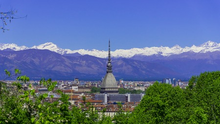 Turin Torino aerial timelapse skyline panorama with Mole Antonelliana, Monte dei Cappuccini and the Alps in the background. Italy, Piemonte, Turin.