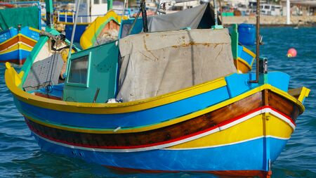 Marsachlokk - MALTA: Colorful Maltese boats in the harbor in Malta in the fishing village of Marsachlokk