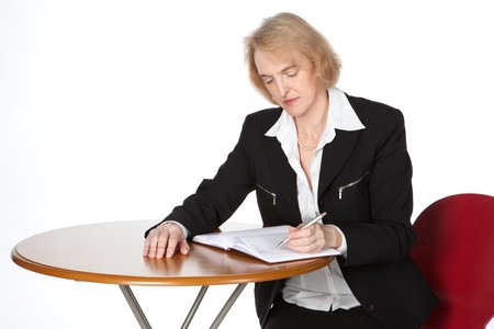 A business woman is writing in her diary photo