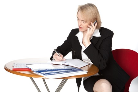 A business woman is working and doing telephone calls photo