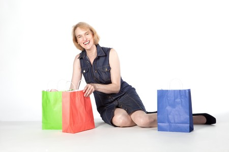 Mature woman out in the city for shopping photo