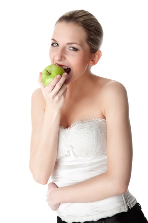 sound bite: A young, beautiful woman eating a green apple Stock Photo