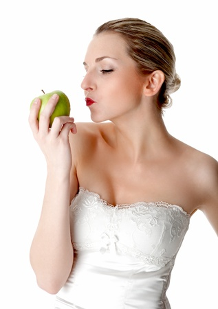 decolletage: A young, beautiful woman holding a green apple