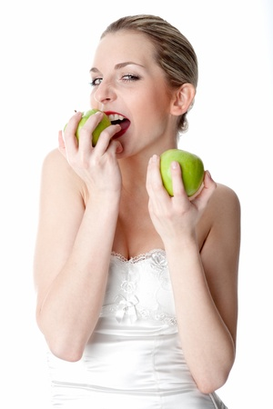 sound bite: A young, beautiful woman holding two green apples
