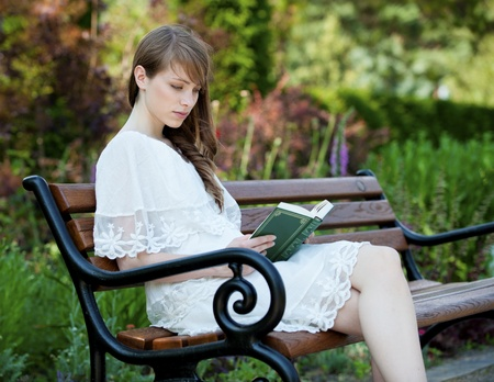 woman reading: A young, beautiful lady enjoys the afternoon  Stock Photo