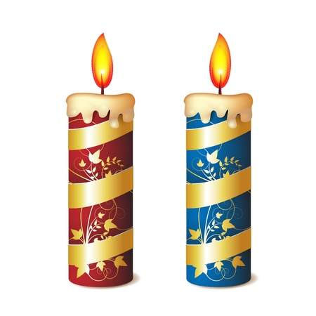 lit candles: Two elegant candles red and blue decorated with gold ribbon