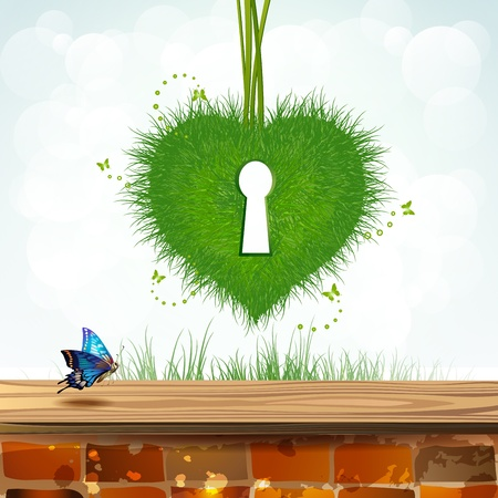 Heart of grass with keyhole over landscape  photo