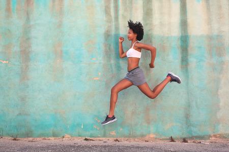 certain: Certain woman running in the street Stock Photo