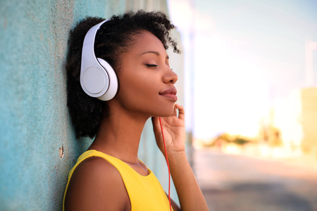 sunbath: Pretty girl listening music with her headphones