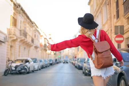 wait: Traveler doing the hitch-hike in the street Stock Photo