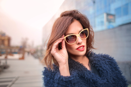 Pretty woman in the blue fur and sunglasses