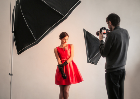 Pretty woman at the photographer Imagens