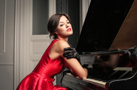 Attractive woman at the piano