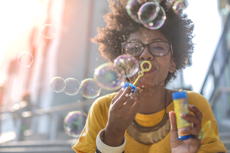 Funny girl is blowing bubbles Imagens