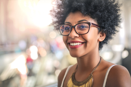 Brazilian woman in glasses is smiling