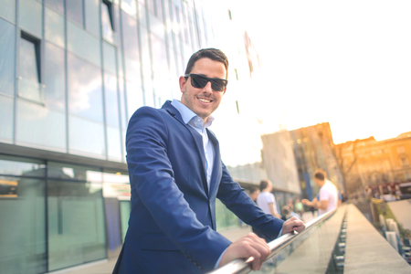 Handsome businessman is sunglasses