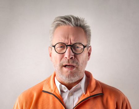 Businessman in glasses is angry