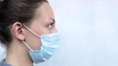 Close up of a woman's face wearing a protectve mask Stock Photo