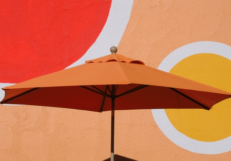 parasol: Orange Parasol with circles Stock Photo