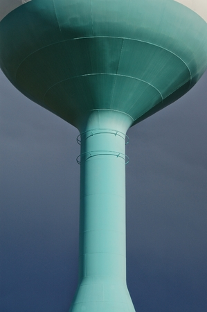 water tower: Water tower with stormy sky in the background Stock Photo