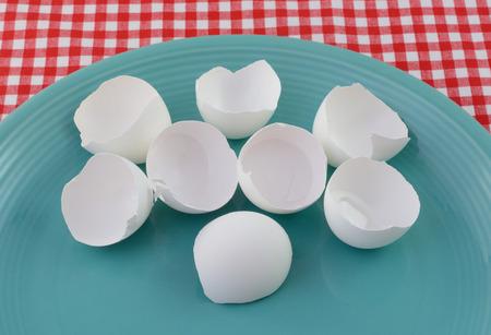 Cracked eggshells on blue plate